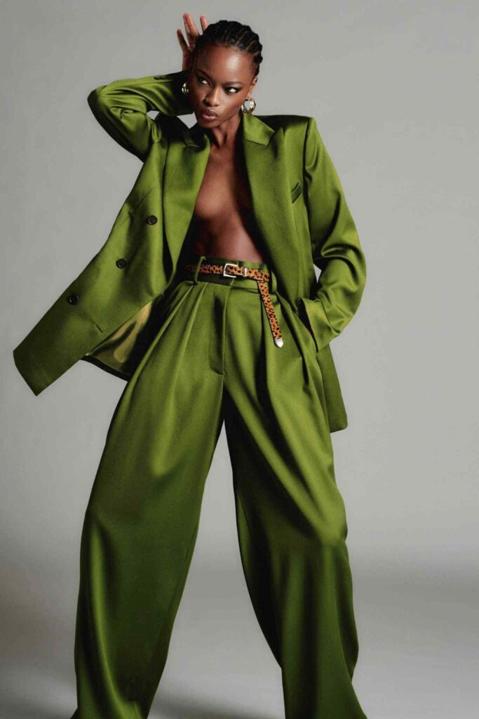 Lady in green wide legged Brandon Maxwell trouser suit